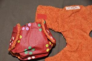 couche à fleurs doublée en éponge orange